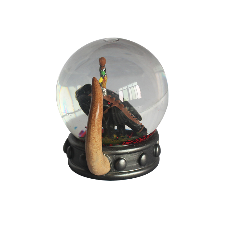 Resin cartoon character home decoration unique customized horn base snow globe