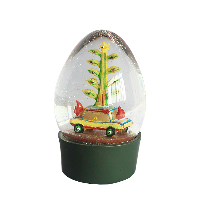 Resin handmade best selling custom gifts home decor green base oval snow globe